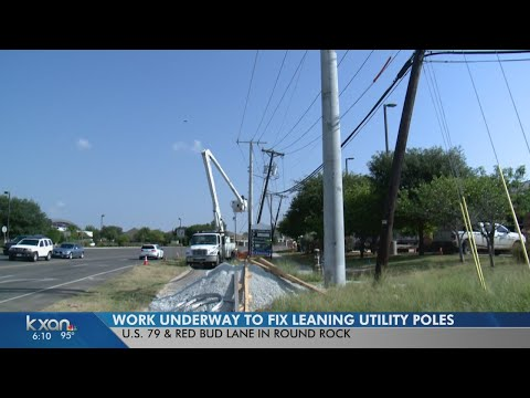Leaning utility poles being fixed along US 79 in Round Rock