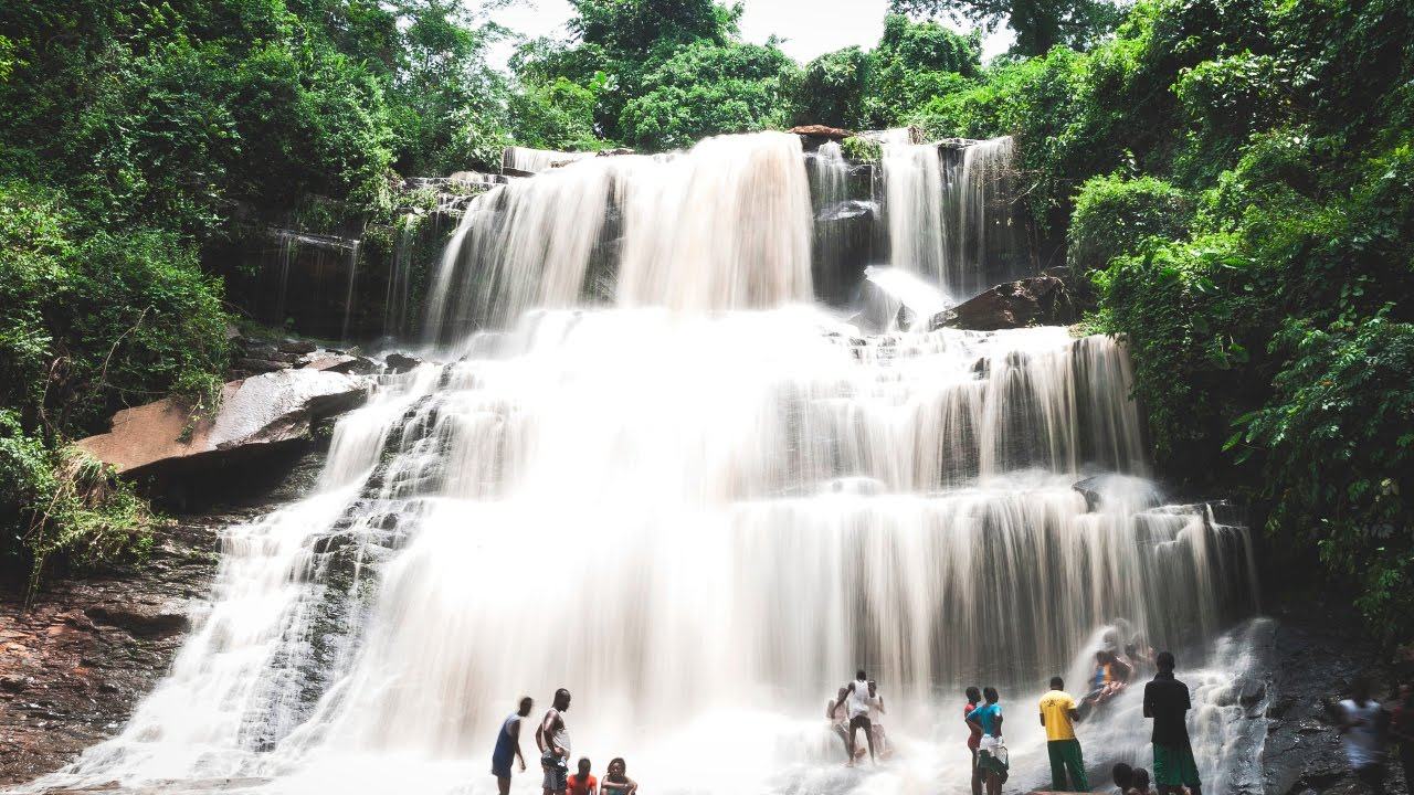 Kintampo waterfalls in Volta region ghana. waterfall people green trees