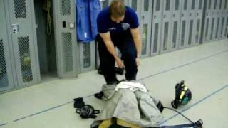 Matt puts on his firefighter gear in a minute.