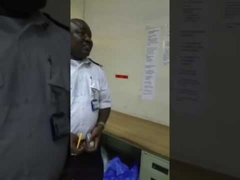 A custom officer in Banjul airport forceful take traveller things