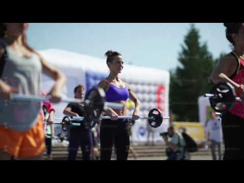 Russia, Novosibirsk, 2016: Women raise the bar. Exercises with a barbell