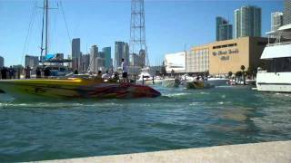Cigarette Boats leave Miami Marina for the start of the Poker Run Nov. 2011