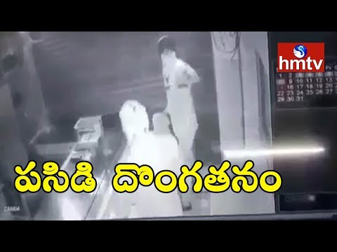 Robbery at Sujatha Jewelry Shop Caught On CCTV Camera In Nirmal District | hmtv