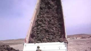 dump truck dumping mud