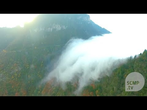 Sea of clouds flows like a waterfall in China's Hubei province