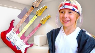 Yarik Sasha and Mom Play musical instruments found Super Toy Electric Guitar and Starts a Band