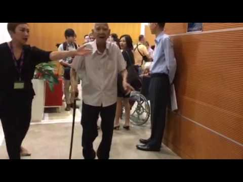 Mr Goh Beng Seng, born in 1913, walking to the press conference