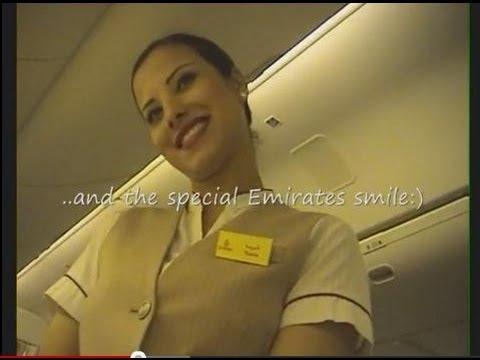 Emirates Business Class:Smiles and Charmes: Beautiful Flight Flight Attendant and Burj Khalifa