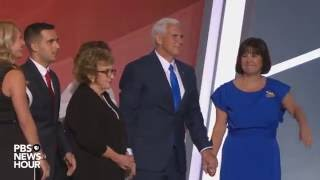 Gov. Mike Pence greets Trump, family on RNC stage