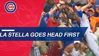 La Stella dives into the stands to make a great grab