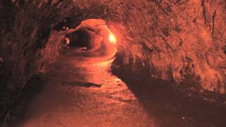 A walk through the Thurston Lava Tube in Hawaii, Volcanoes National...