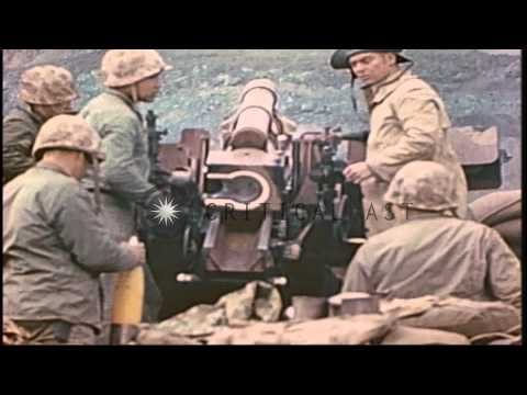 US Marines fire howitzer at Mount Suribachi on Iwo Jima during World War II, Carr...HD Stock Footage