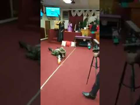 Woman Preacher Goes Rambo in Church