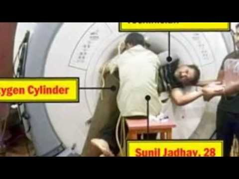 Two hospital workers spend FOUR HOURS pinned to MRI machine by metal oxygen tank