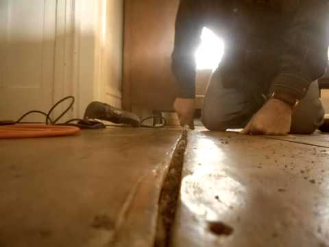 1 Repairing Gaps In Wood Floors Step One Of Four Cleaning Out The