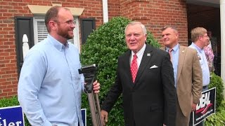 Georgia Governor Nathan Deal greets a Democratic tracker at Roswell Republican Rally 08/02/14