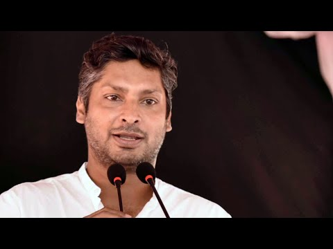 Kumar Sangakkara speaks at an event in Lunugamvehera