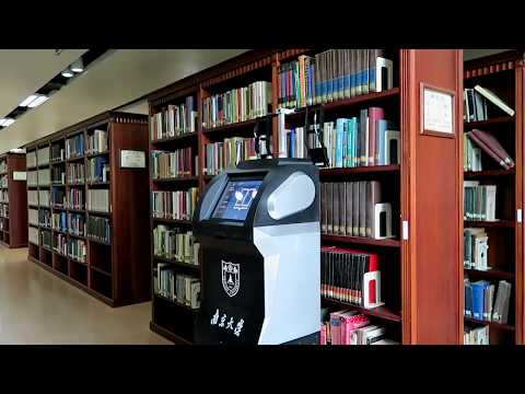 RF-Scanner: Shelf Scanning with Robot-assisted RFID Systems