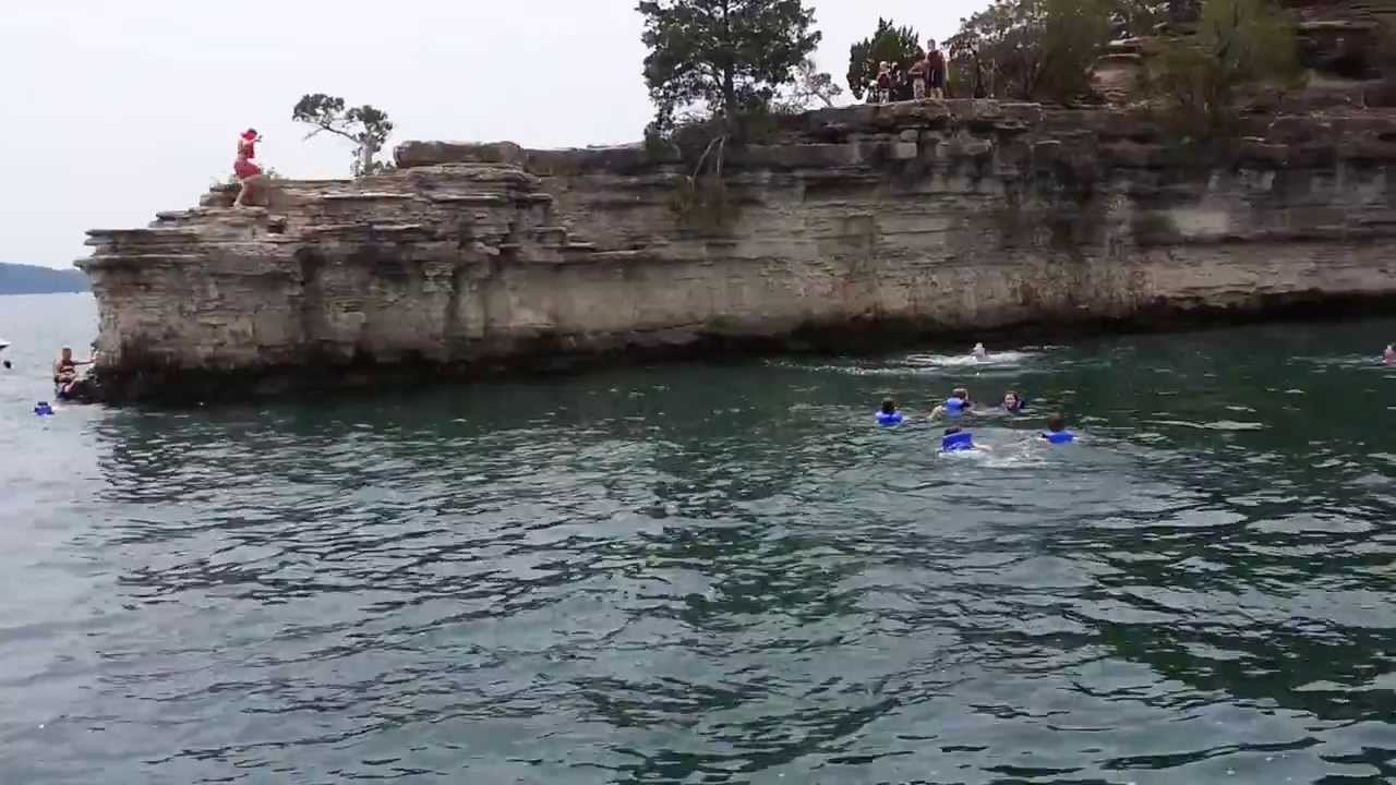 Tyler jumps off the cliff at Table Rock Lake into the ...