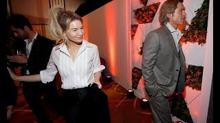 When stars DON'T collide: Brad Pitt slips away from Renee Zellweger at the Academy Awards Nominees L