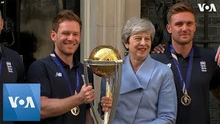 UK Prime Minister Theresa May Celebrates World Cup Victory with England Cricket team