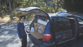 Stealth Mini Van camper conversion tour. Unique kitchen and sliding bed frame.