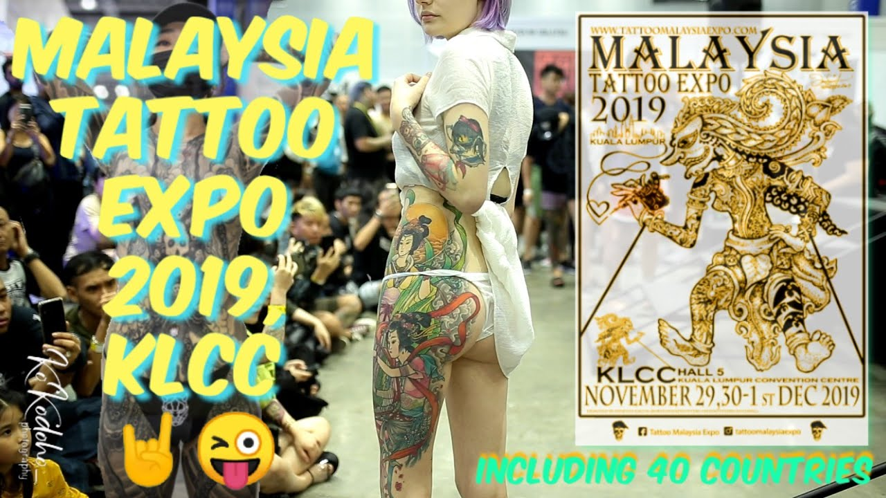 Malaysia slams tattoo expo as porn over half-naked pics
