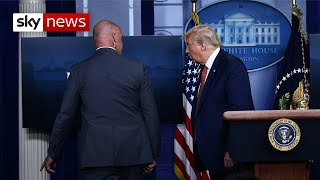 Trump escorted from news briefing after shooting outside White House