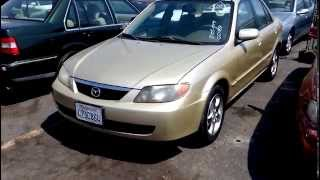 Осмотр автомобиля Mazda Protege перед покупкой на аукционе eBay