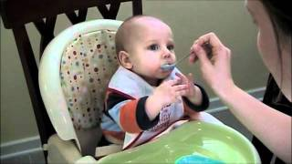 Happy 6 months old baby eating for the first time!