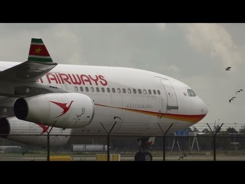 AIRBUS A340-311 Suriname Airways taxies along highway A5 @ AMS Schihol