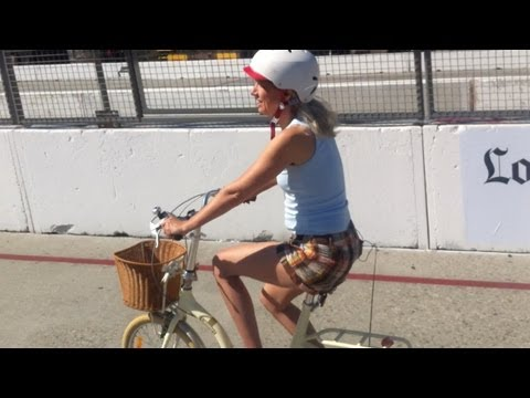 Cute Girl Rides her Citizen Bike through the Long Beach Grand Prix Course