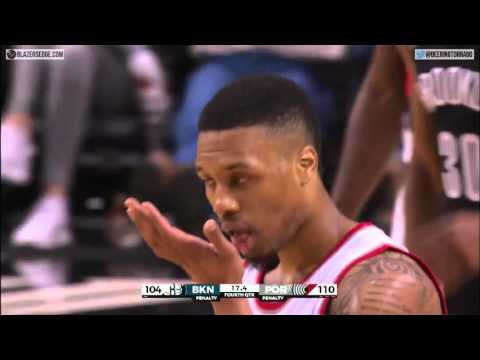 Lillard hits 65 foot (almost) and-1