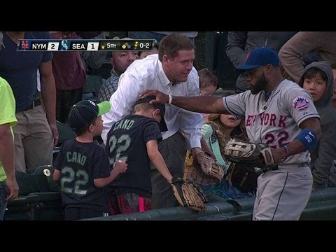 Young Jr. leaps into stands, helps young fan