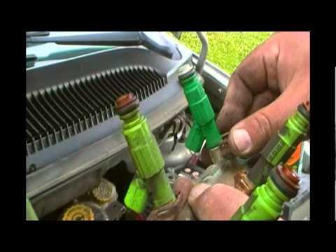 Changing a fuel injector  2002 Dodge Caravan  YouTube