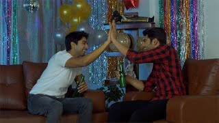 Two Indian male buddies giving high five while chatting and celebrating New Year or Christmas Eve