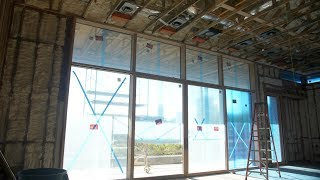 Loewen Lift & Slide Doors inside a Curtain Wall Window System