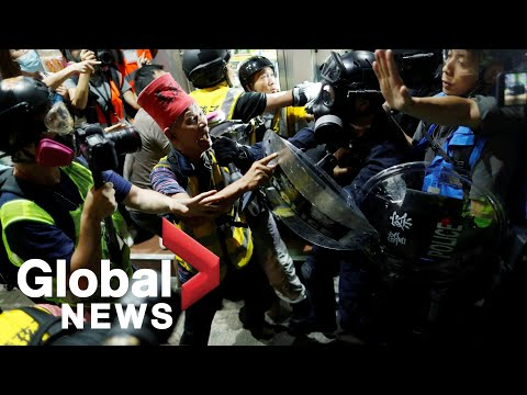 Hong Kong protests: Riot police clash with protesters outside Yuen Long station