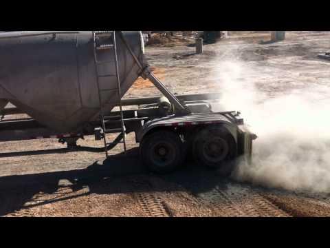 GT Sirizzotti- Spreading Soil Cement Over Subgrade