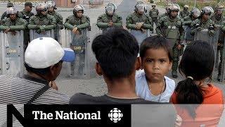 Tensions mount in Venezuela amid rival aid shipments