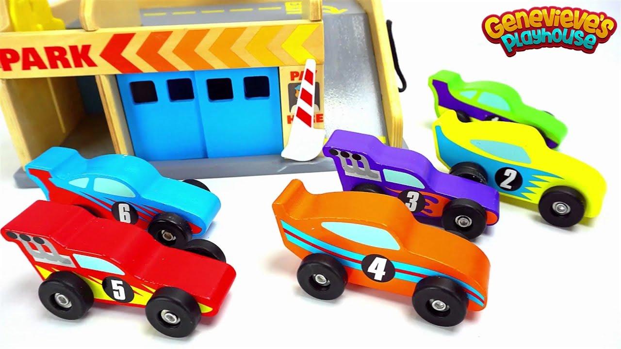 ensinar-cores-do-bebe-com-carros-do-brinquedo-do-divertimento