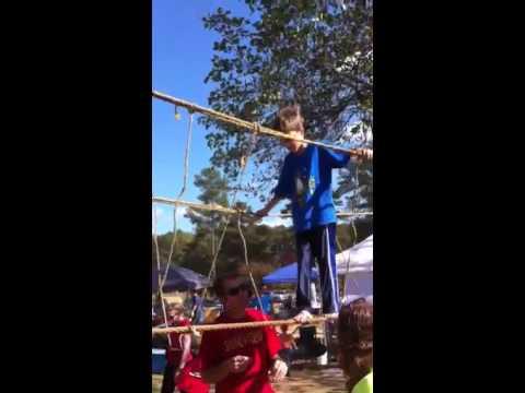 Louis walks a tightrope.