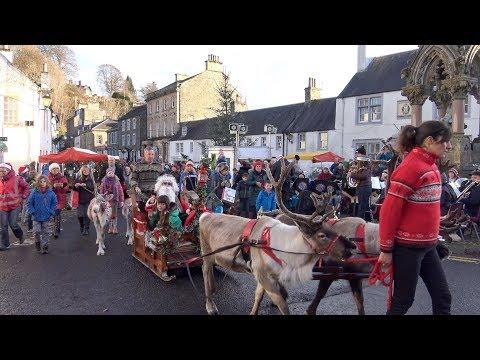 2017 Christmas parade as reindeer pull Santa through Dunkeld & Birnam in Perthshire, Scotland