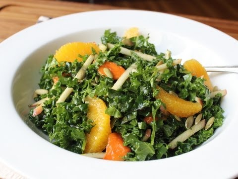 Raw Kale Salad Sliced Raw Kale with Apples, Oranges, Persimmons & Nuts