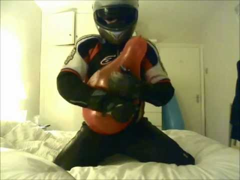 Balloon stomp and hug-popping session in bike gear
