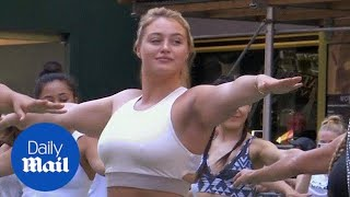 Iskra Lawrence joins Yoga summer solstice celebration in Times Square - Daily Mail