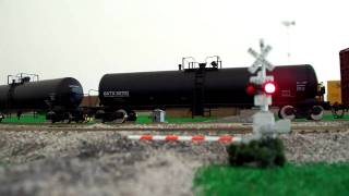 Athearn SD70ACe at railroad crossing on my DCC layout