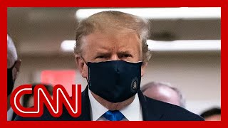 Trump wears a mask for first time in front of press pool