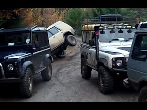 Land Rovers wading flooded tracks in Bala forest. Accident of a DISCO 1 after it turned over
