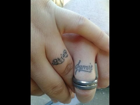 name ring tattoos on fingers